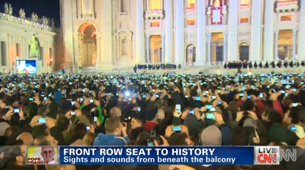 Pope Francis greeted by a multitude of smartphone cameras
