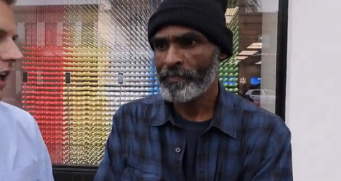 Homeless folk duped by man who promises to pay them for a nightlong wait at Apple Store