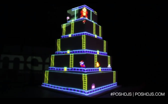 Behold the coolest wedding cake ever that plays classic games onto it