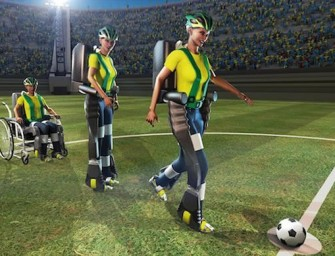 Paralyzed teenager wearing a robotic exoskeleton to kick the first FIFA World Cup ball