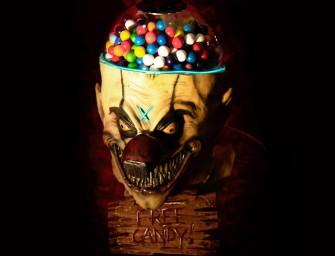 Decapitated clown head with razor teeth promises free gumballs!