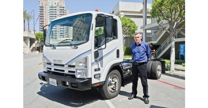 Tesla-co-founder-steers-garbage-trucks-2